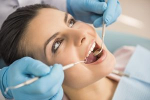 A woman having a dental exam.